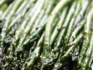 Fresh asparagus sauteed in a cast iron skillet with garlic and butter. This Garlic Sauteed Asparagus recipe is quick, easy and the perfect side dish for a steak dinner.