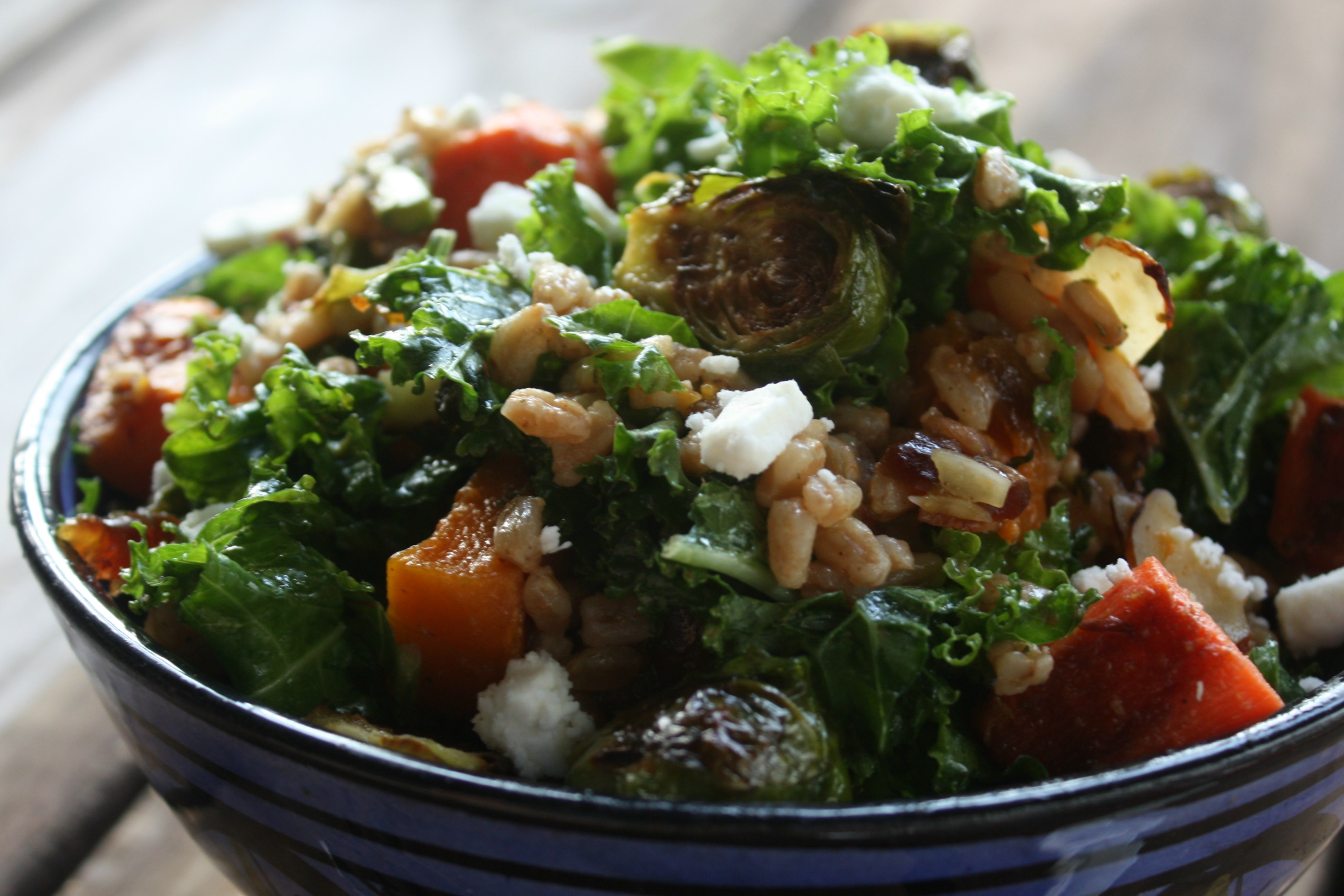 Kale and Farro Salad with Roasted Vegetables and Feta Cheese.