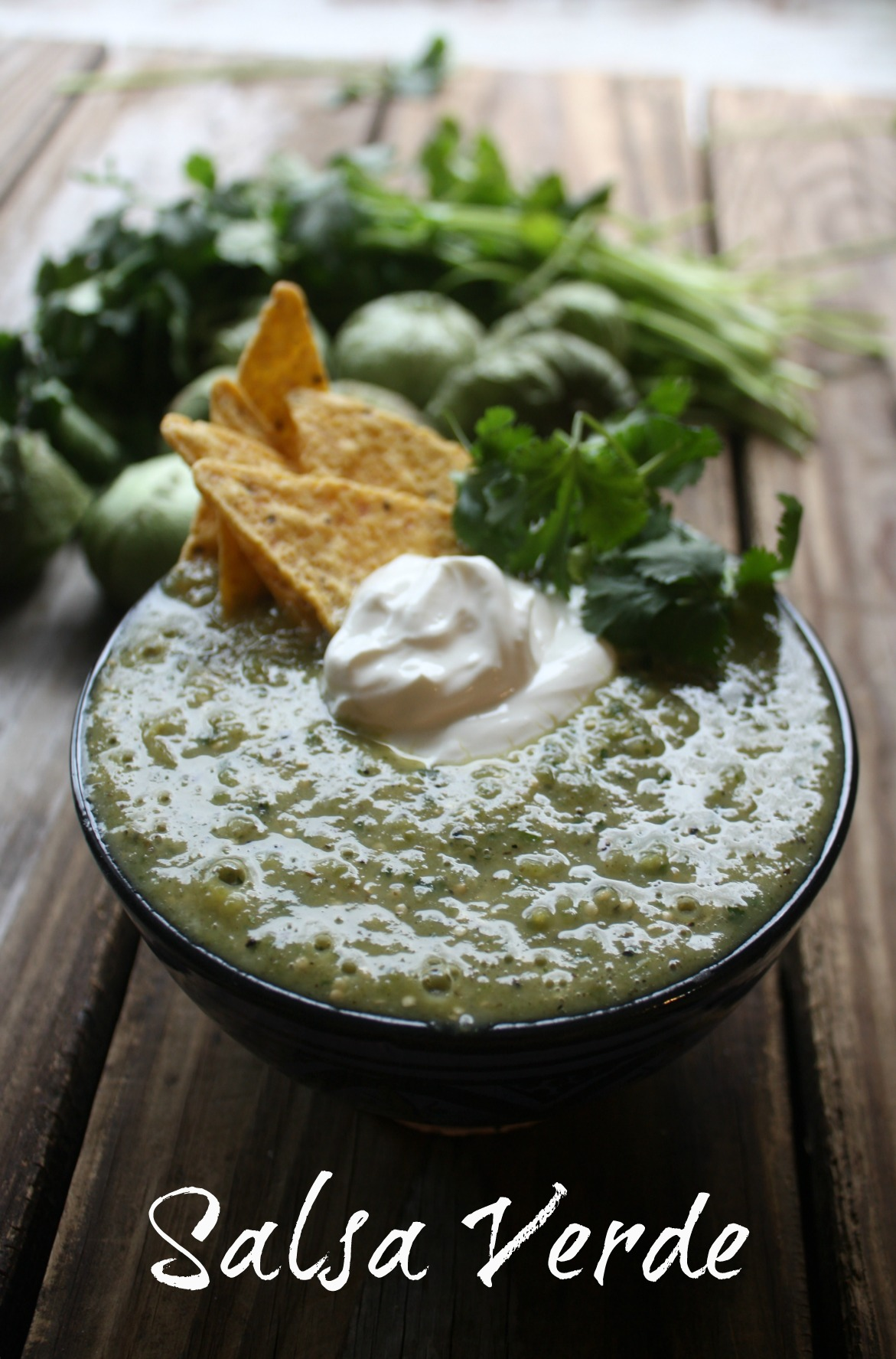 This Salsa Verde or Green Salsa is a roasted blend of tomatillos, jalapenos, garlic and onion that get a whirl in a blender with fresh cilantro and lime juice to make the best and easiest Salsa Verde.