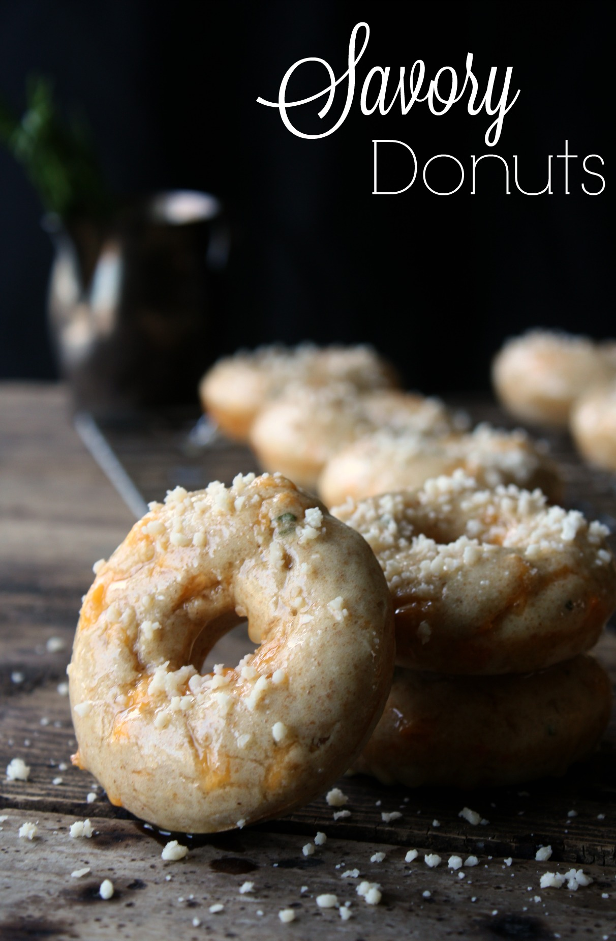 Savory Donuts. These savory donuts are baked with cheddar and herbs and sprinkled with Parmesan cheese. These donuts replace toast in my eggs over easy breakfast.