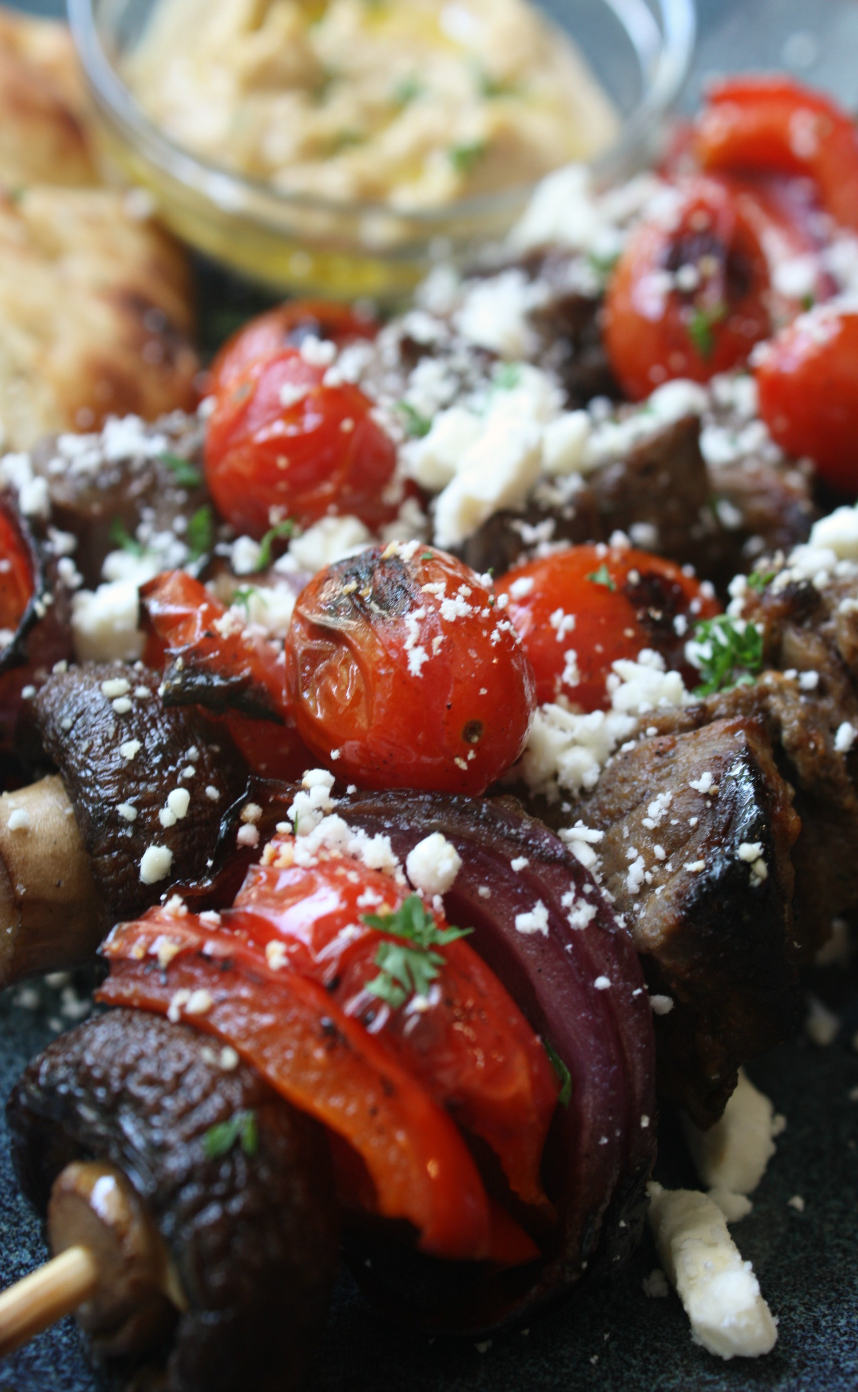 Marinated beef kabobs skewed with mushrooms, red bell pepper and red onions then grilled. Once the beef kabobs come off the grill they are topped with blistered cherry tomatoes and sprinkled with feta cheese.