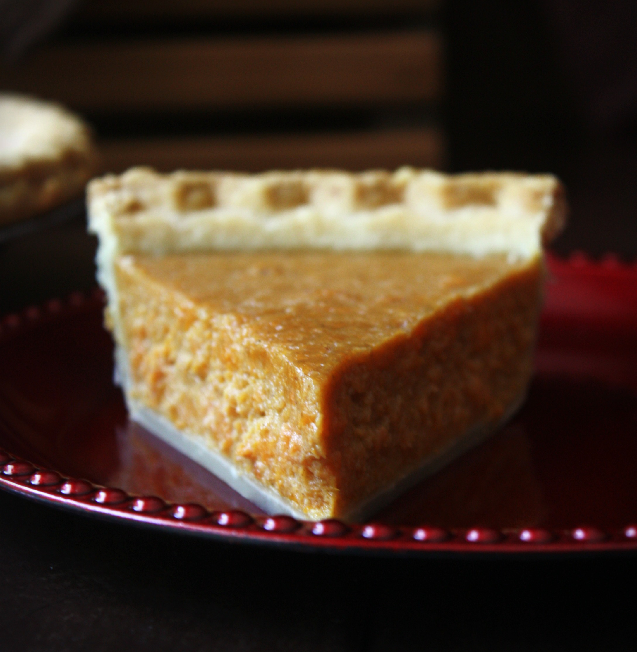 This Sweet Potato Pie is spiced with cinnamon and nutmeg with hints of vanilla and molasses. This traditional Southern dessert is perfect for Thanksgiving and Christmas holidays.