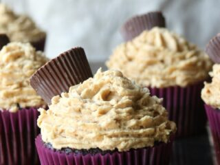 Chocolate Peanut Butter Cupcakes recipe topped off with mini peanut butter cups candy. Rich chocolate cake with a fluffy peanut butter frosting recipe.