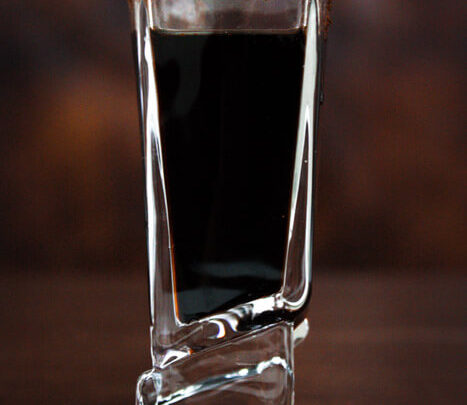 Black Russian Shots with a coffee rim.